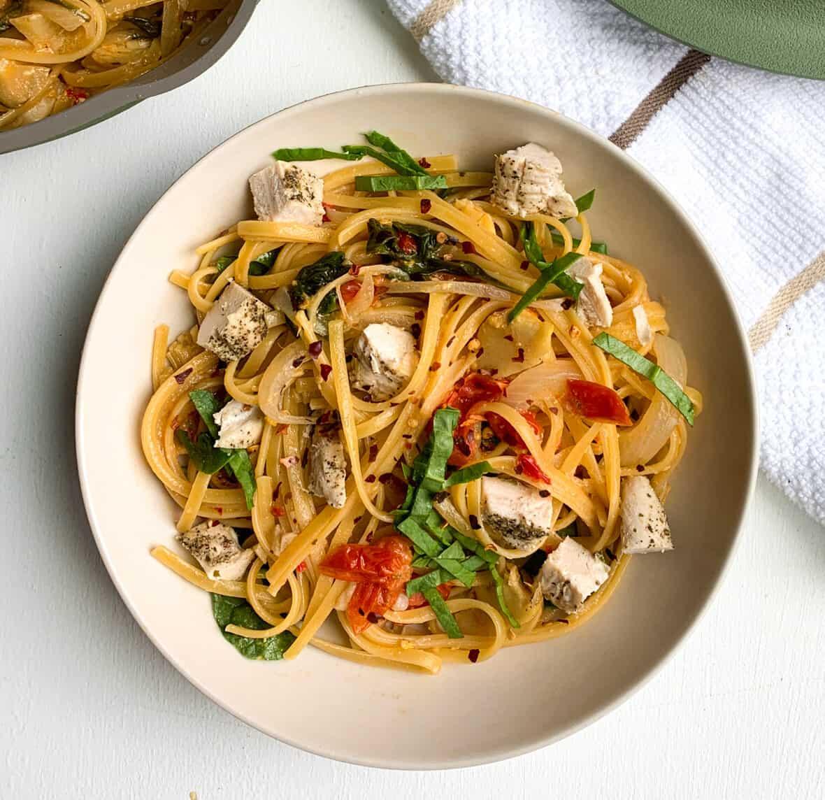 one pan spinach artichoke and tomato pasta