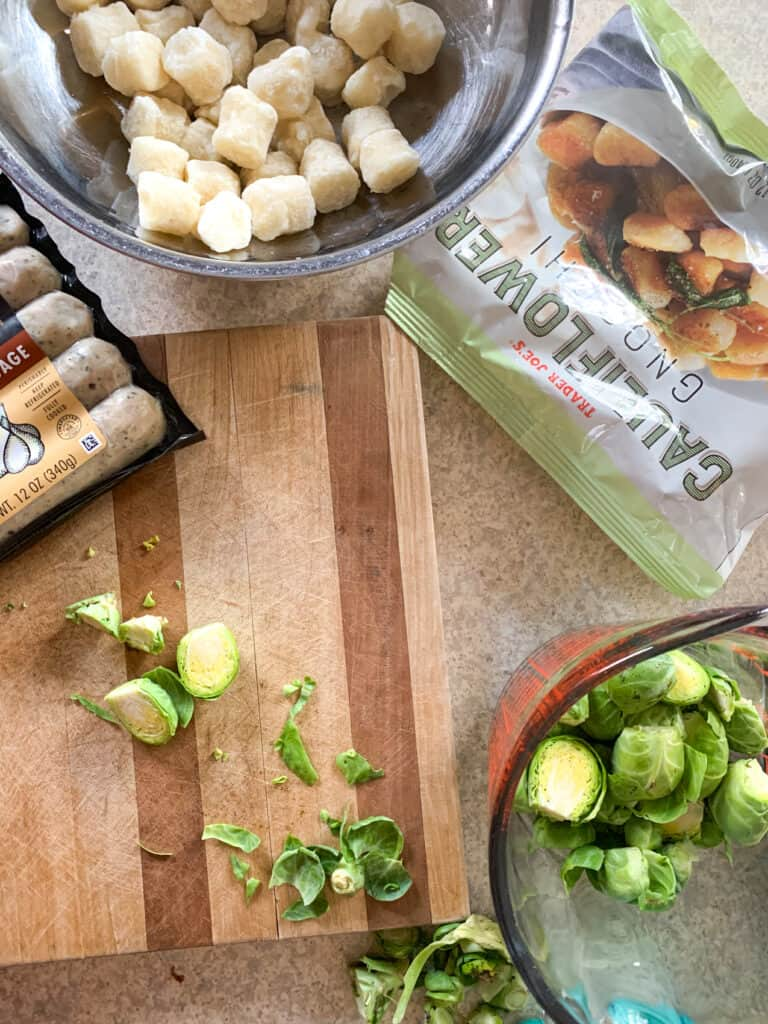 sheet pan cauliflower gnocchi, brussels sprouts and chicken sausage ingredients flat lay