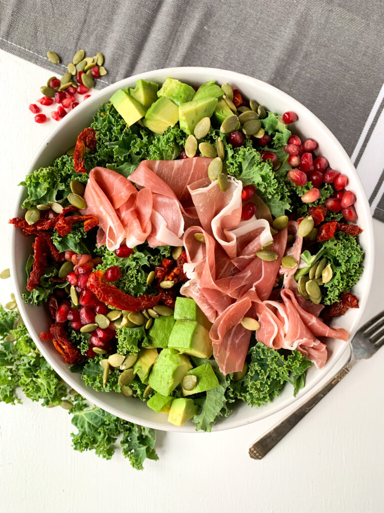 prosciutto and pomegranate kale salad