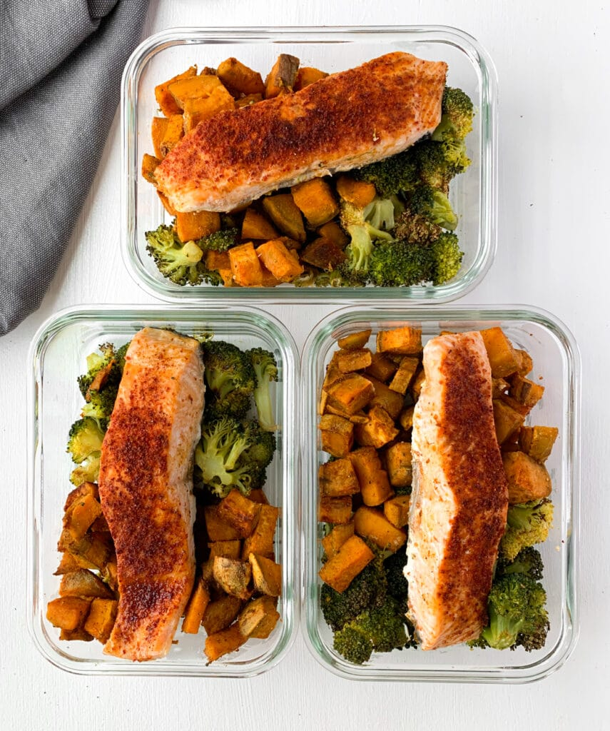 meal prepped sheet pan salmon broccoli and sweet potatoes