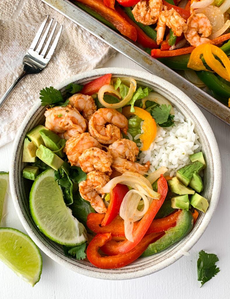 sheet pan shrimp fajitas in a burrito bowl